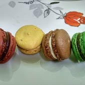 Red, yellow, brown and green french macarons