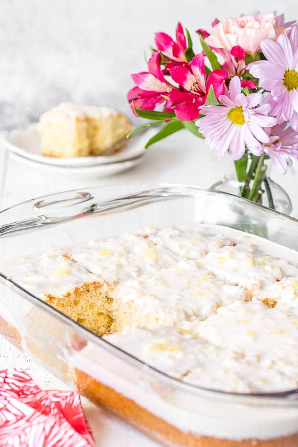 Insanely easy pineapple cake with pineapple cream cheese frosting comes together with only 5 ingredients and 10 minutes of your time! Big reward for very little effort, and feeds a crowd! #pineapplecake #sheetcake #Easterdessert #Eastertreat #dessertforcrowd