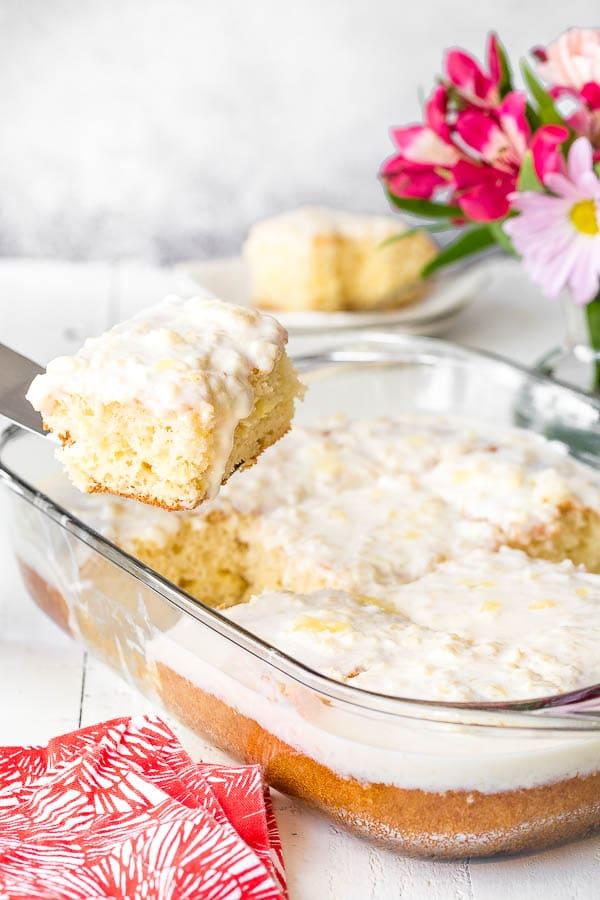 Insanely easy 5-ingredient pineapple cake with pineapple cream cheese frosting! Big reward for very little effort, and feeds a crowd! #pineapplecake #sheetcake #Easterdessert #Eastertreat #dessertforcrowd