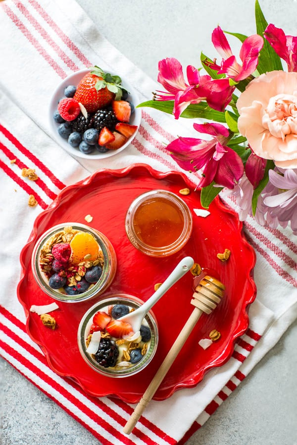 Throwing Spring brunch for a special occasion? Well, I have a great idea for you! Effortless, yet chic this colorful make-your-own-parfait bar is easy to put together and is sure to impress. #brunch #yogurtparfaitbar #brunchmenu #bridalshower #springbabyshower