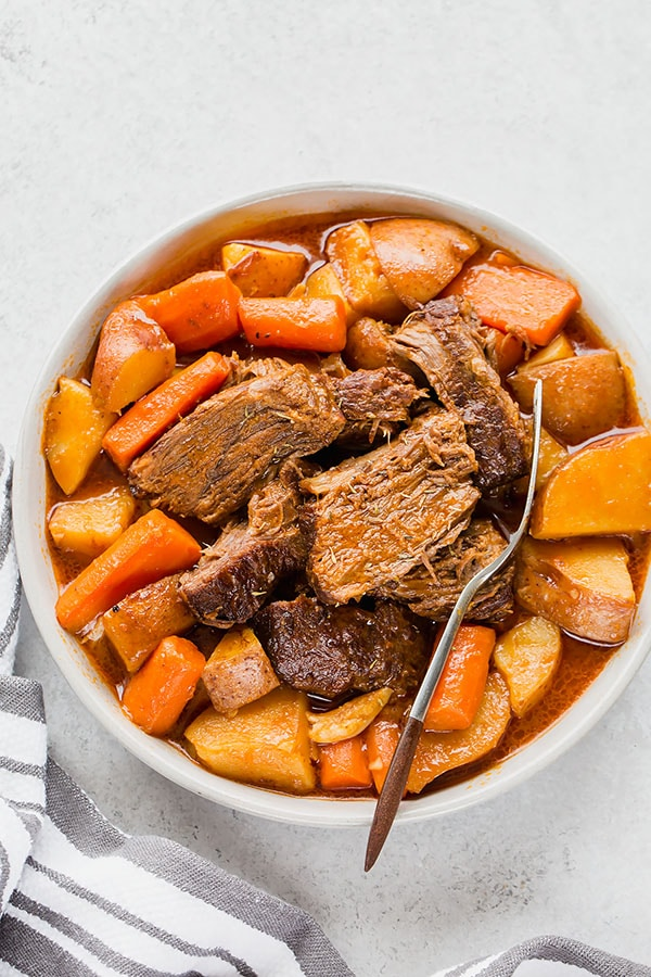 Cooking flavorful, well-marbled chuck roast (I used home-raised wagyu beef) low and slow in a dutch oven yields melt-in-your-mouth tender and unbelievably flavorful pot roast! Easy pot roast recipe for the BEST one pot meal! #potroast #onepotmeal #beefroast #wagyubeef #comfortfood