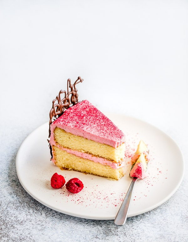 Moist vanilla cake from scratch is simply the best! It's so easy to make and enjoy! #birthdaycake #vanillacake #layercake #raspberrycreamcheesefrosting #creamcheesefrosting