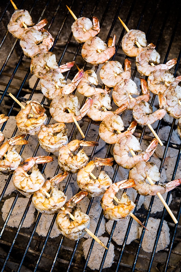 Quick and easy grilled shrimp, bursting with flavor! Such an easy dinner for hot summer days. #easydinner #appetizer #shrimpskewers #jamaicanjerkshrimp #grilledshrimp