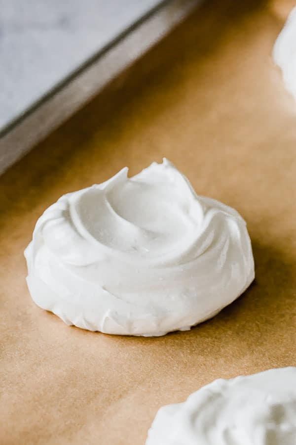 Mini Pavlova before going into oven. Simple meringue mounds are just as elegant. #minipavlova #easydessert