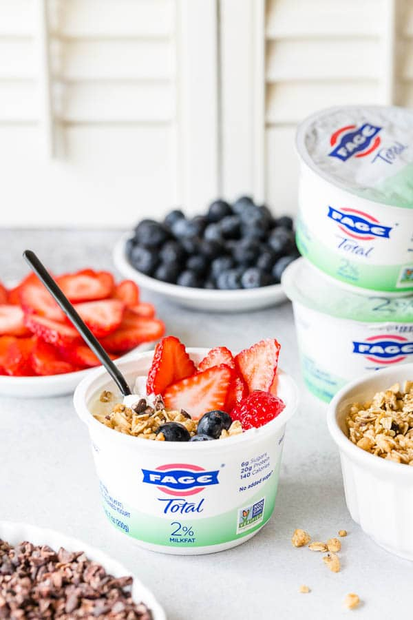 Classic yogurt bowl with fresh berries, granola and cocoa nibs. Healthy breakfast and/or afternoon snack made easy, fun and delicious! #yogurtbar #snack #healthysnack #snacktime #yogurtbowl