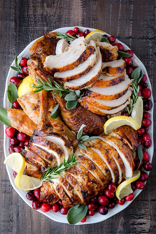 Calling all lemon lovers!!! This lemon herb roast turkey is for you! Infused with tangy lemon butter inside and rubbed with mixture of lemon pepper, garlic & herb seasonings and lemon zest, this roast turkey will surprise your taste buds (in a pleasant way!) this Thanksgiving. #ThanksgivingTurkey #turkey #thanksgivingrecipe #thanksgiving #wholeturkey