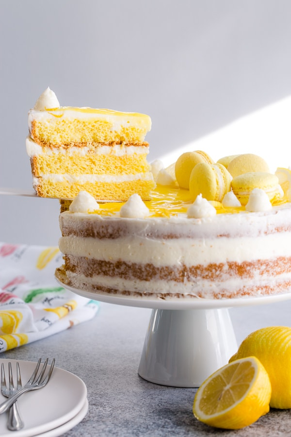 Tangy sweet and irresistibly light and airy, this lemon layer cake is bursting with zesty lemon through and through! Light sponge cake layers infused with lemon simple syrup and homemade lemon curd, and then filled with velvety lemon Swiss meringue buttercream frosting.