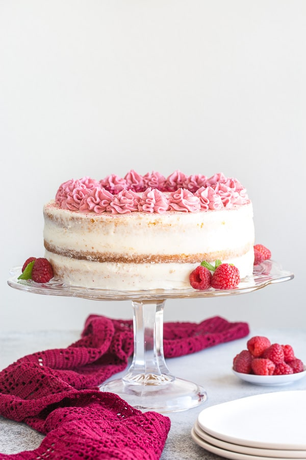 Delicate sponge cake layers filled with creamy sweet cream cheese frosting and raspberry jello made with real fruits. Gorgeous, tall and impressive cake for any occasion.