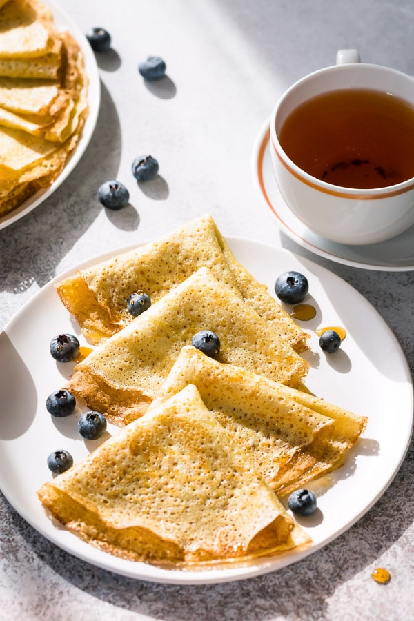 Homemade crepes are a perfect weekend breakfast! Sharing my tried and tested tips for making perfect crepes every time! #crepes #homemadecrepes