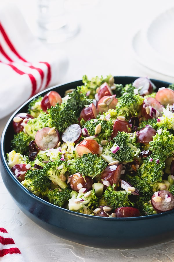 This quick and easy broccoli salad, loaded with flavors and texture, is a perfect side dish for family gatherings and celebrations! Not only is it a delicious crowd-pleaser, it's also great to make it in advance! #broccolisalad #salad