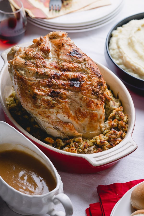 Ultimate Thanksgiving dinner on a small scale, cooked entirely in an Instant Pot in one go! Magic? Nah, just Instant Pot doing its thing!!! So this's what we have on our Thanksgiving menu: Thanksgiving turkey breast with stuffing and mashed potatoes. Plus, gravy!! #Instantpotturkeybreast #thanksgivingdinner #boneinturkeybreast
