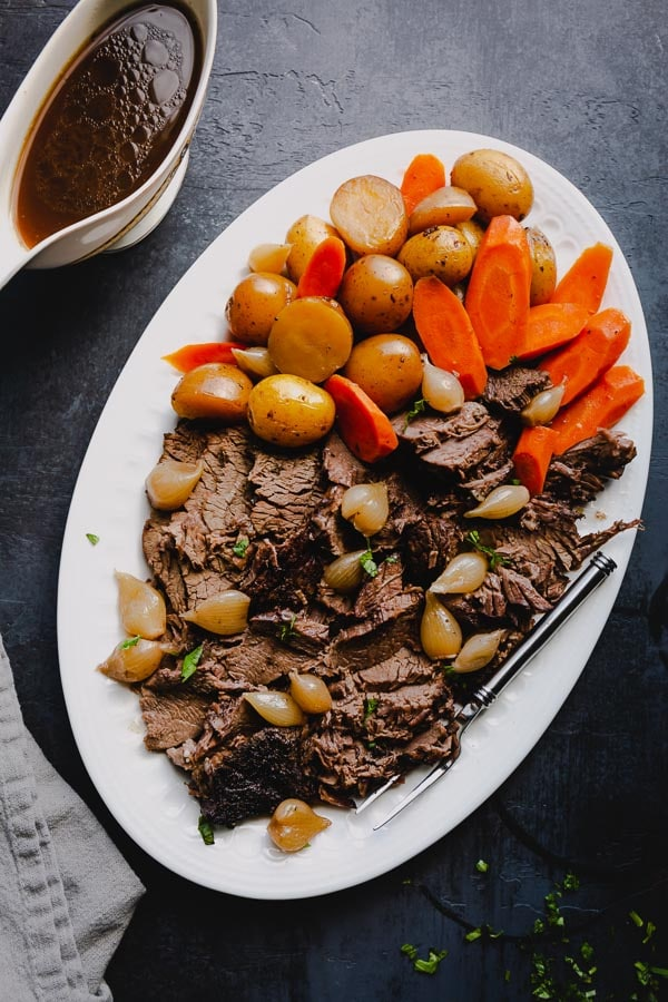 A classic pot roast recipe is perfect for Sunday dinners with enough for leftovers all week long. This recipe is a simple staple for your recipe box! #potroast #beef #chuckroast