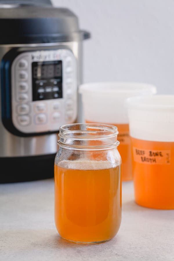 Beef bone broth is a kitchen staple! Easily store this in the freezer for quick uses for pastas, stews, soups and more! #bonebroth #stock #beefbonebroth #kitchenstaples