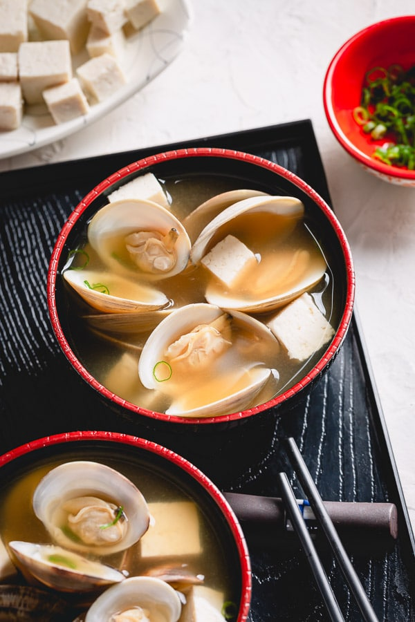 Easy miso soup recipe requires only 2 ingredients, plus optional add-ins! This simple, yet deliciously satisfying, soup is so easy to make at home! In this post, you'll learn what is miso paste, how to choose one and where to buy it. #misosoup
