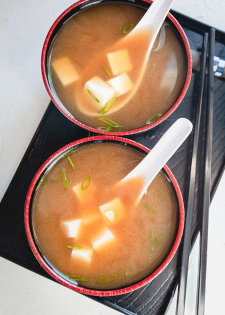 Made with only 5 ingredients, Easy Miso Soup Recipe is an earthy, simple, and delicious, soup to accompany many Japanese dishes. Don't let the miso paste or dashi fool you. Authentic Miso Soup is easy to make anytime! #misosoup #japanesefood #soup #easy #asian
