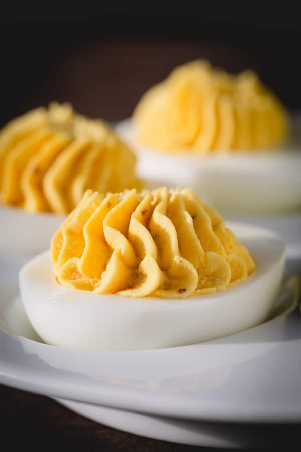 Classic deviled eggs with perfectly creamy and well-rounded filling. Get the tested recipe as well as all the tips on how to make them ahead! Simple yet tasty appetizer for any occasion! #deviledeggs
