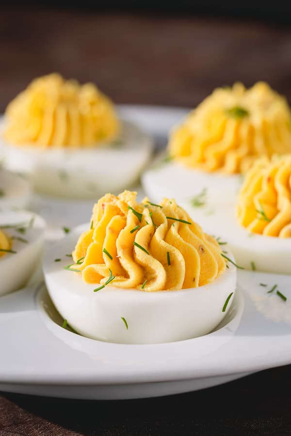 Perfect deviled eggs with perfectly creamy and well-rounded filling. Get the tested recipe as well as all the tips on how to make them ahead! Simple yet tasty appetizer for any occasion! #deviledeggs