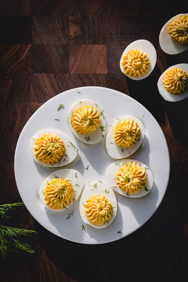 Deviled eggs are such a simple, yet tasty appetizer that never disappoints! This classic recipe is a keeper! #deviledeggs