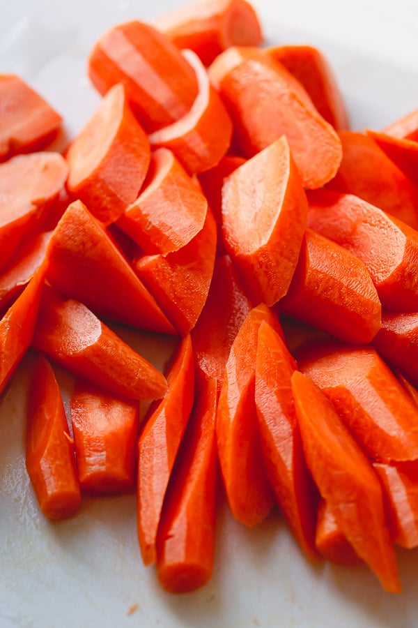 Root vegetables, like carrots (pictured), are perfect for roasting with a whole chicken.