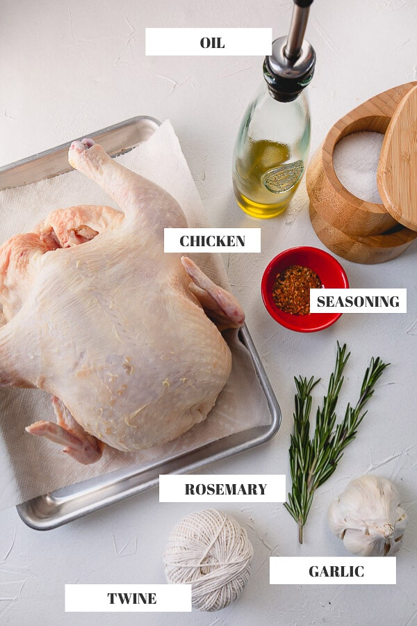 Perfect roast chicken doesn't require a lot of ingredients. For a simple roast chicken you'll need a whole chicken, oil, seasonings, rosemary (optional) and garlic! And a kitchen twin for tying the legs for even cooking. #roastchicken