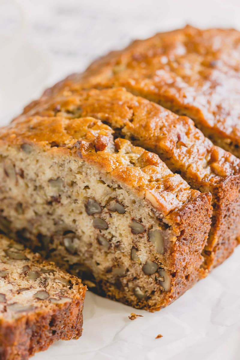 My go-to banana bread recipe since 2013! This recipe makes two moistest and most flavorful banana breads with simple ingredients and just a wooden spoon! #bananabread