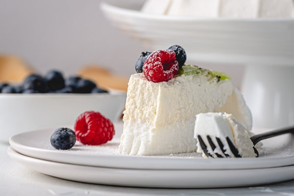 This easy Pavlova recipe is perfect for beginners! Equipped with my time-tested tips and tricks, you too can make an impressive Pavlova right in your kitchen.
