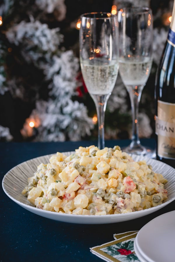 Classic holiday dinner staple, this Russian potato salad is SO satisfying and easy to make!  #russiansalad #russianpotatosalad #oliviersalad