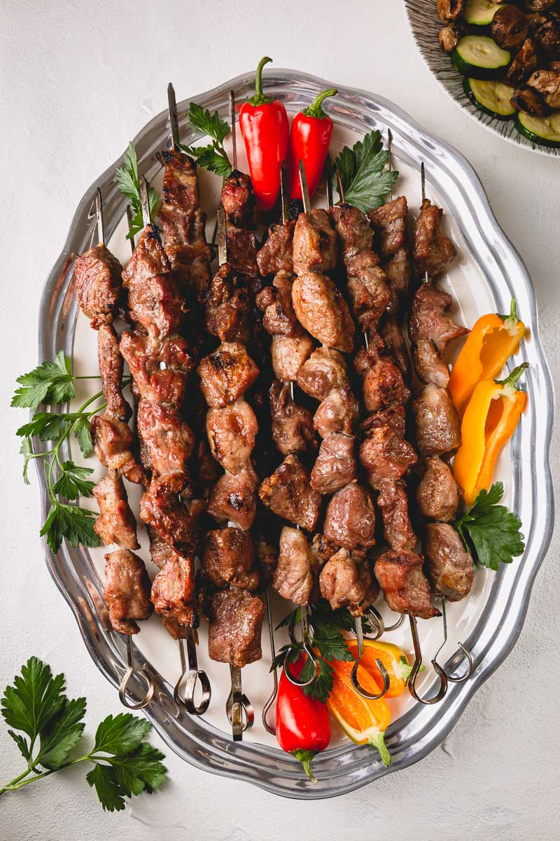 Grilled pork kebabs (shashlik, in Russian) is the summer staple! Here's how to make the juiciest and most tender grilled pork skewers with simplest marinade. #porkkebabs #shashlik