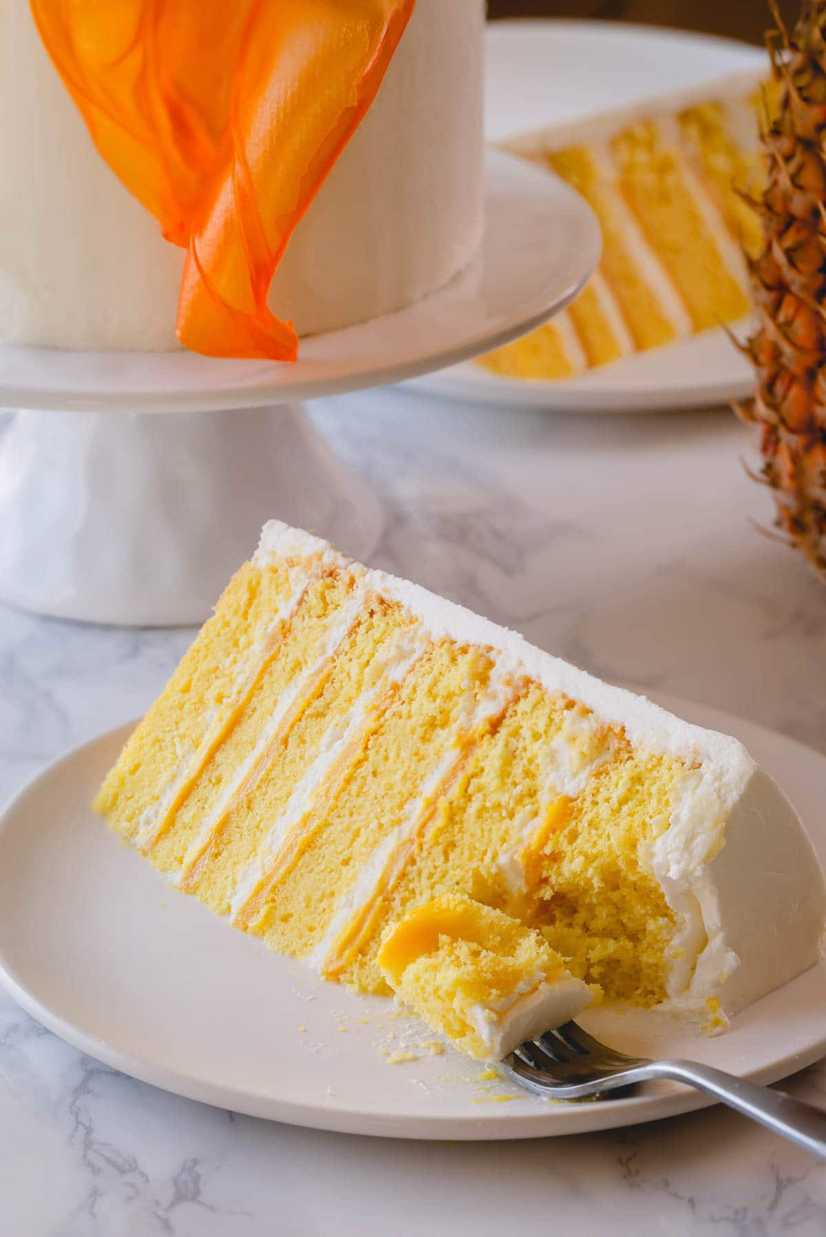 Pineapple cake on plate with fork
