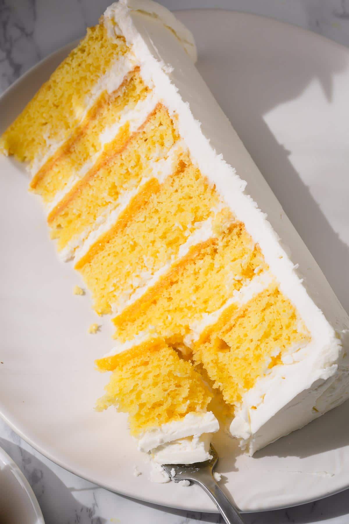 Slice of pineapple layer cake on plate
