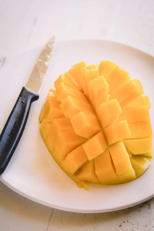 Mango half sliced into cubes.