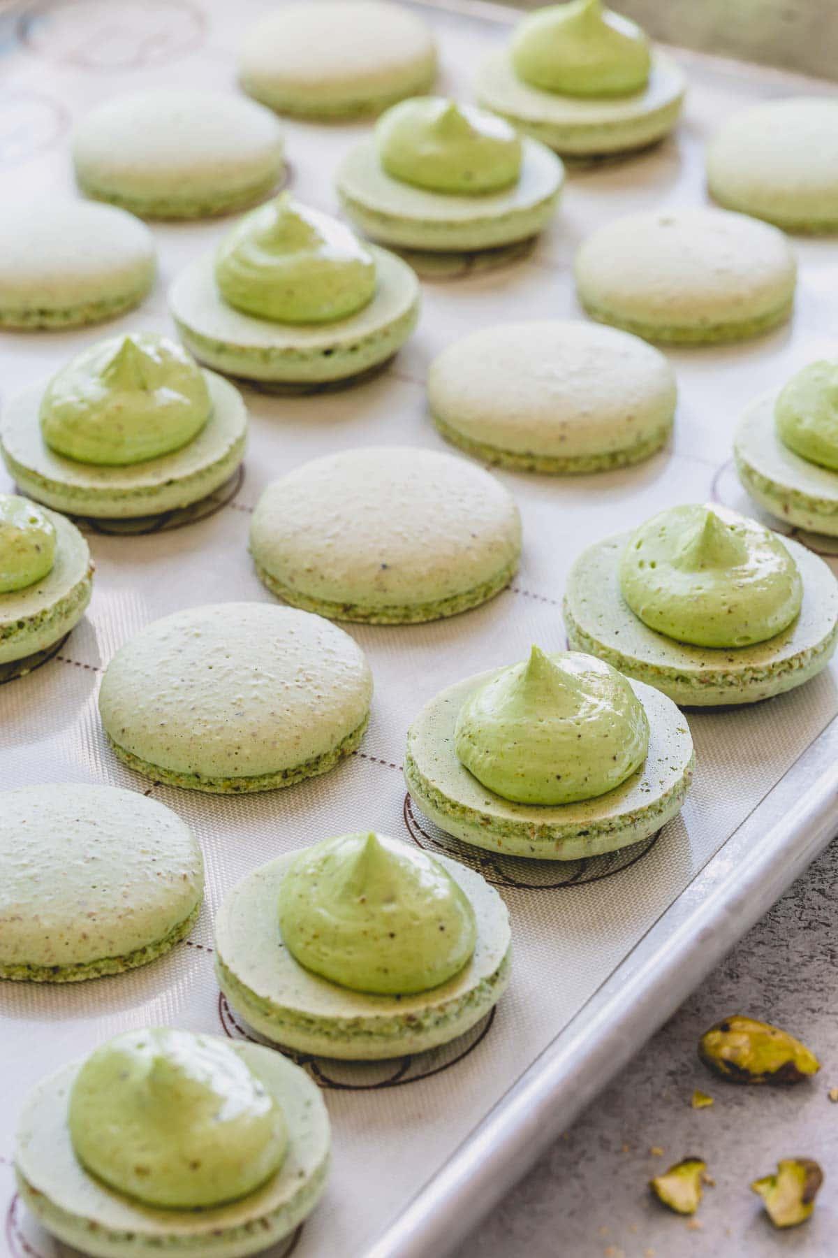 open pistachio shells with a dollop of pistachio cream filling