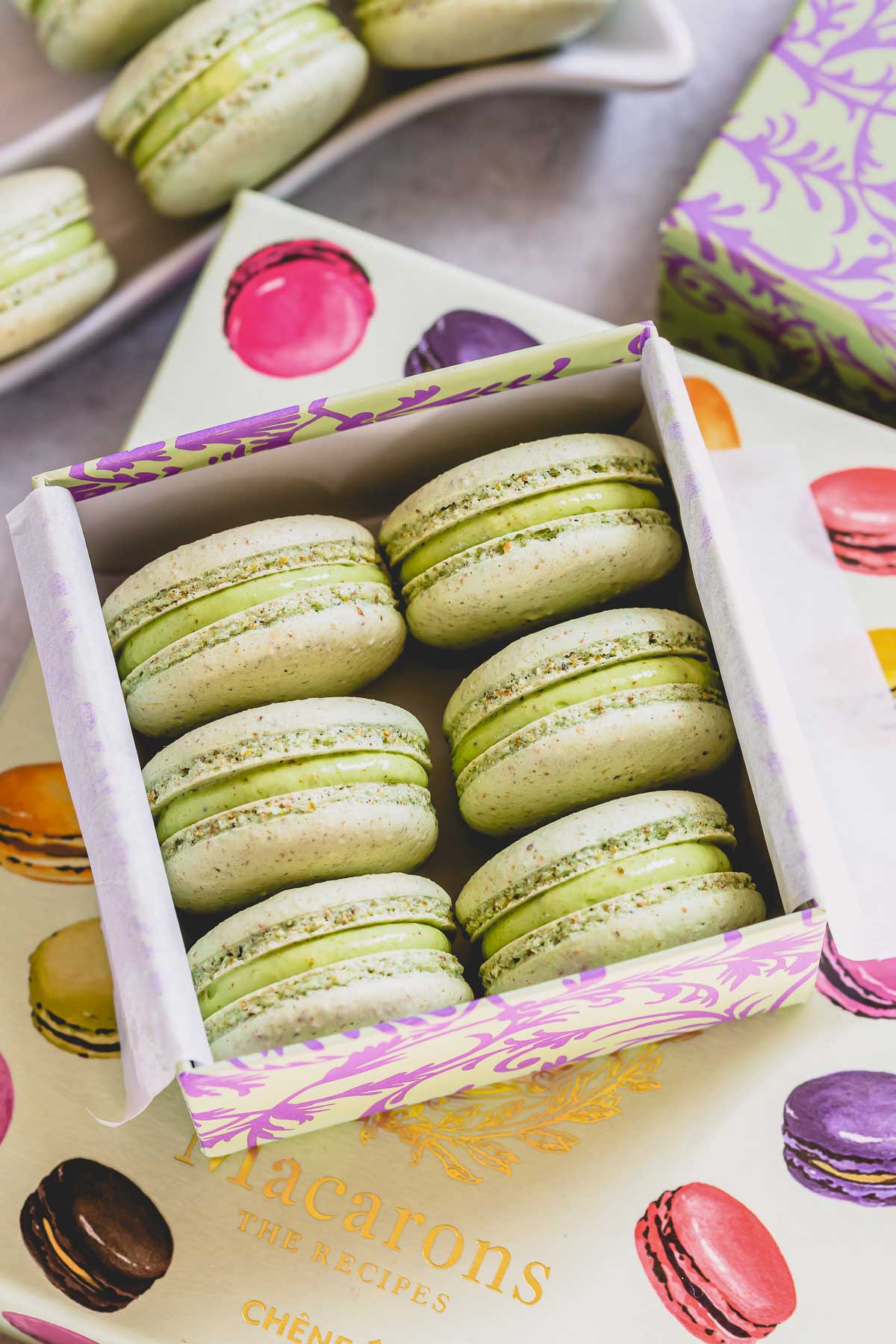 pistachio macarons in a box