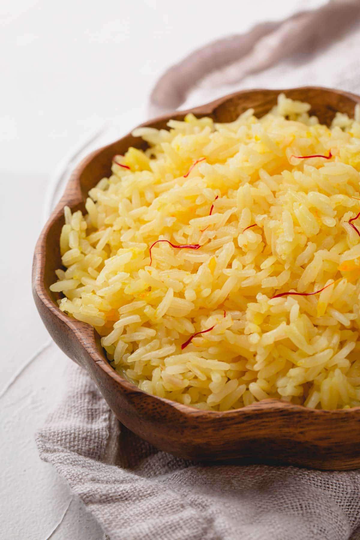 cooked Saffron Rice in wooden bowl