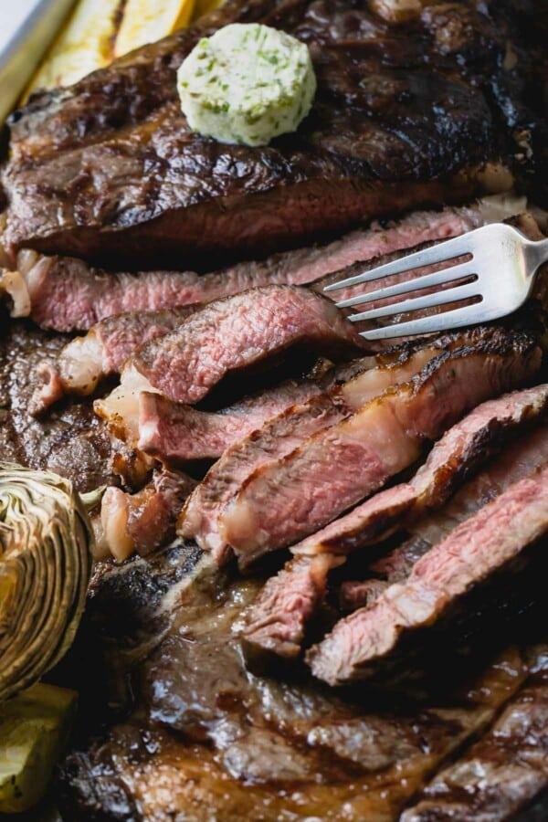 Sliced grilled ribeye steak.