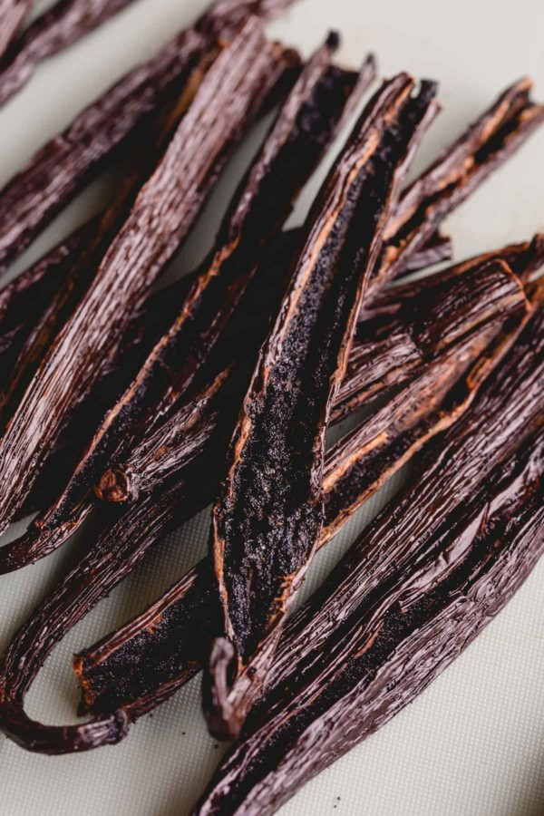 Vanilla beans sliced lengthwise with exposed seeds.