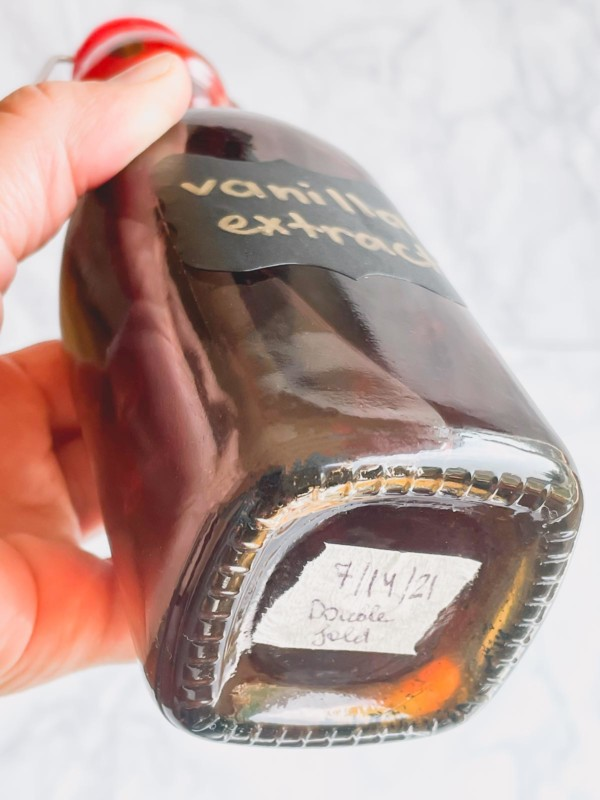 The bottom of bottle with a label of a date.