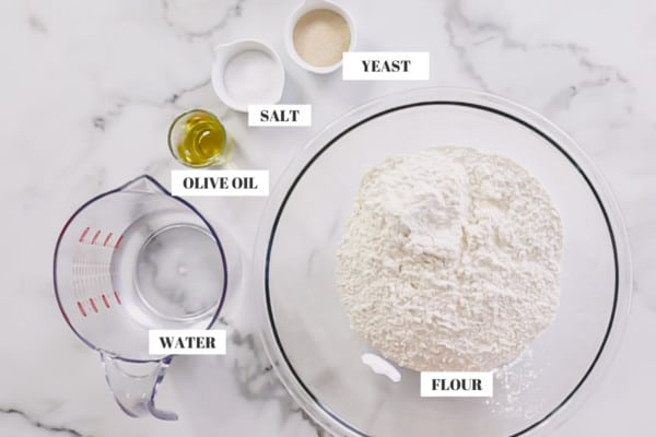 pizza dough ingredients: flour, water, olive oil, salt and yeast.