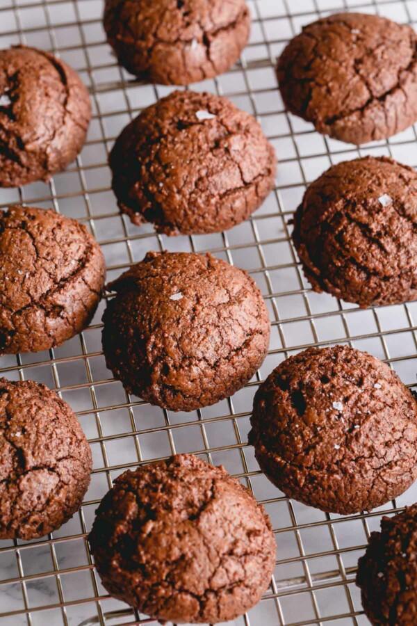 Brownie cookies on a cooling rack.